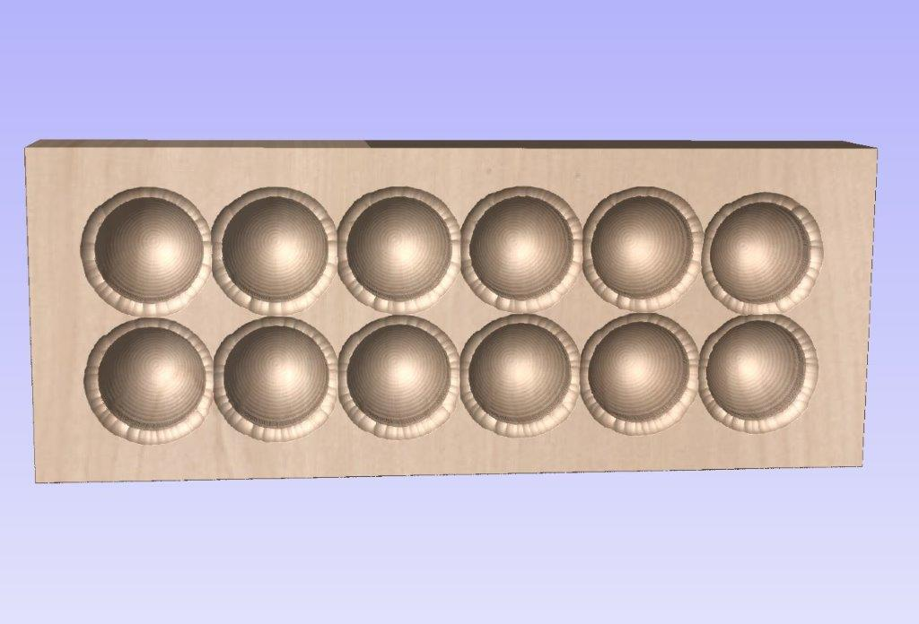 Egg Carton Rough and Finish showing unwanted cut to tip of ball nose outside of model.jpg