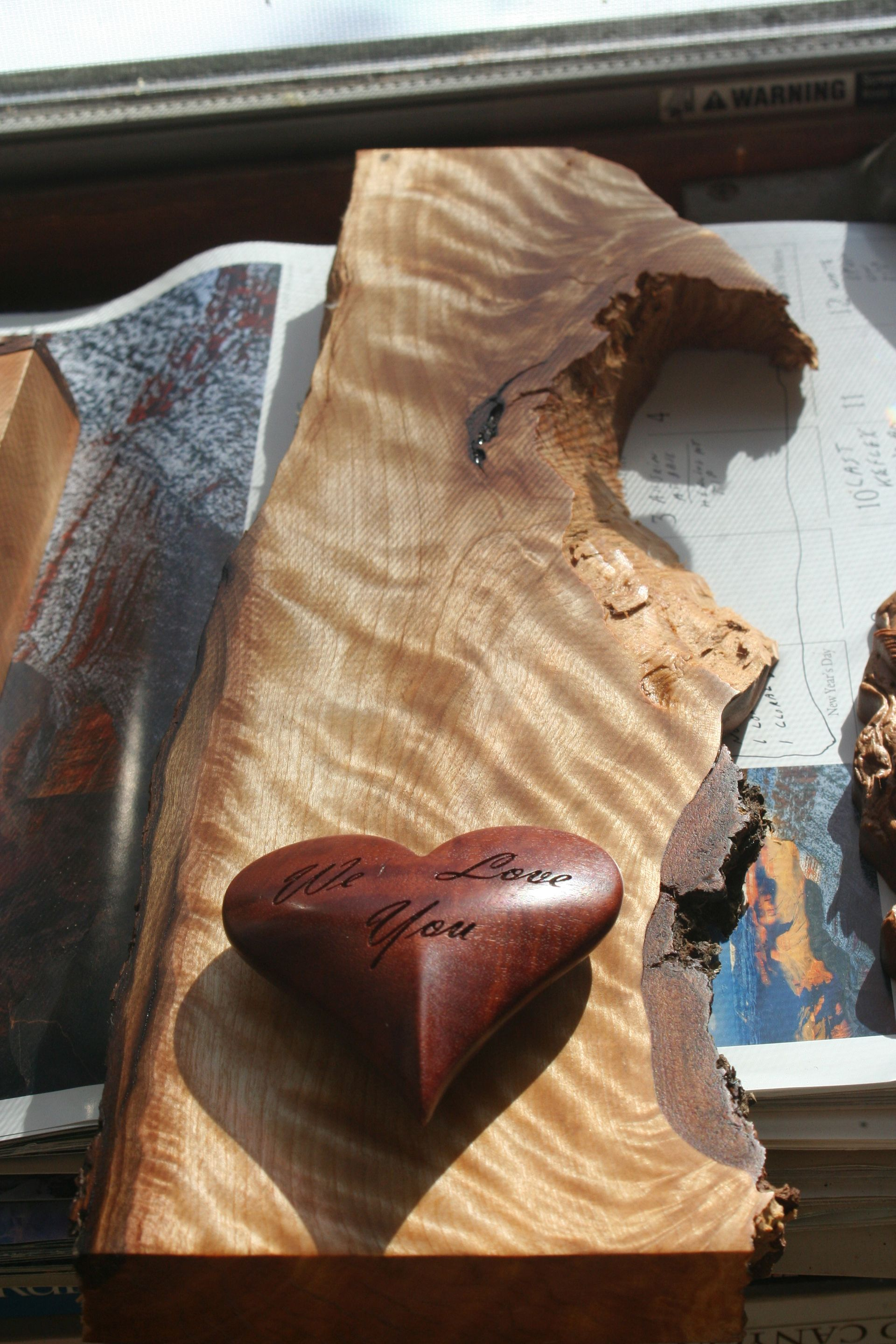 2.4.19 MOMS HEART RIVER RED GUM ON FIREWOOD.jpg